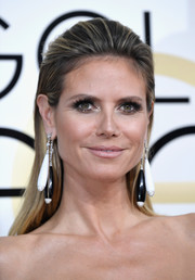 Heidi Klum hit the Golden Globes wearing a straight hairstyle with a teased top.