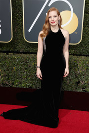 Jessica Chastain cut a shapely silhouette in this black Armani Privé fishtail gown with metallic sides at the 2018 Golden Globes.