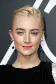 Saoirse Ronan teamed her updo with gorgeous gemstone drop earrings by Cartier.
