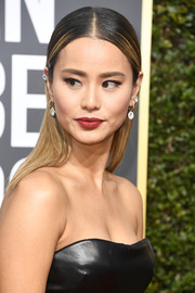 Jamie Chung added some bright sparkle with a pair of dangling diamond earrings by Chopard.