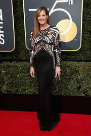Allison Janney vamped it up in a body-con Mario Dice gown with a sheer-panel, embroidered bodice at the 2018 Golden Globes.