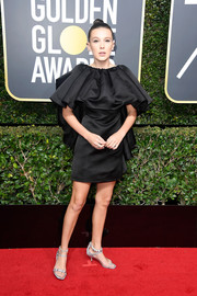 Millie Bobby Brown got frilled up in a Calvin Klein By Appointment ruffled LBD for the 2018 Golden Globes.