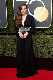 Katherine Langford looked divine in a pleated black Prada gown with a crystal-accented midsection at the 2018 Golden Globes.
