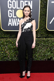 Alexis Bledel was all about cool glamour in a black-and-white Oscar de la Renta jumpsuit with leaf sash detail at the 2018 Golden Globes.