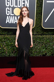 Madeline Brewer worked a super-sultry vibe in a black Diane von Furstenberg halter gown with a partially sheer, tasseled skirt at the 2018 Golden Globes.