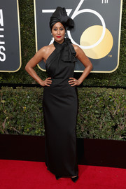 Tracee Ellis Ross went full-on glam in a black Marc Jacobs halter gown complete with a matching turban at the 2018 Golden Globes.