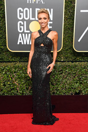 Giuliana Rancic got glitzed up in a black sequin column dress with a crisscross neckline and a triangular cutout for the 2018 Golden Globes.