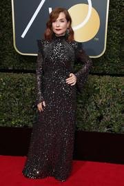 Isabelle Huppert was all about diva glamour in a gunmetal sequin gown by Chloé at the 2018 Golden Globes.