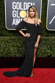 Renee Bargh glittered like a starry night in a sequined black off-the-shoulder gown by Rachel Gilbert at the 2018 Golden Globes.