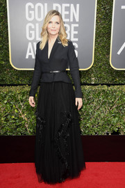 Michelle Pfeiffer softened her menswear-chic top with a tulle and feather maxi skirt, also by Dior Couture.