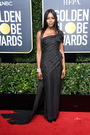 Naomi Campbell looked impeccable in a structured one-shoulder gown by Jean Paul Gaultier at the 2018 Golden Globes.