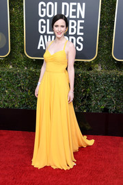 Rachel Brosnahan brightened up the Golden Globes red carpet with her yellow Prada gown.