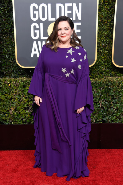 Melissa McCarthy looked adorable in a purple Reem Acra gown with star and ruffle detailing at the 2019 Golden Globes.