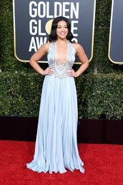 Gina Rodriguez looked va-va-voom in a plunging pastel-blue halter gown by Reem Acra at the 2019 Golden Globes.