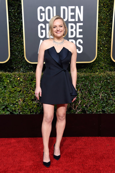 Elisabeth Moss stood out from a sea of gowns in a tux-inspired strapless mini dress by Dior Couture at the 2019 Golden Globes.