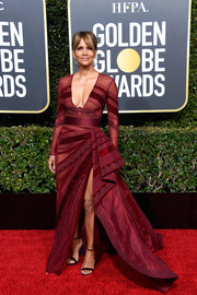 Halle Berry looked ageless and glam in a plunging burgundy gown by Zuhair Murad Couture at the 2019 Golden Globes.