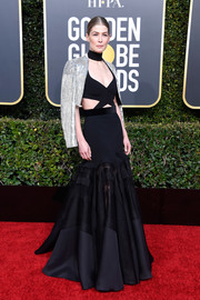Rosamund Pike was bondage-glam in a black cutout gown by Givenchy Couture at the 2019 Golden Globes.