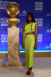 Danai Gurira teamed her dress with black patent sandals by Christian Louboutin.
