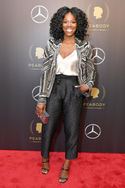 Yvonne Orji looked sharp in a sequined and beaded blazer by Naeem Khan at the 2018 Peabody Awards.