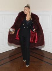 Fergie arrived for the Two Ten Footwear Foundation dinner looking glam in a burgundy fur coat.