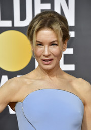 Renee Zellweger styled her hair into a retro updo for the 2020 Golden Globes.