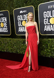Nicole Kidman cut a svelte silhouette in a strapless red column dress by Atelier Versace at the 2020 Golden Globes.