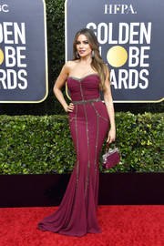 Sofia Vergara sheathed her famous curves in a strapless plum gown by Dolce & Gabbana for the 2020 Golden Globes.