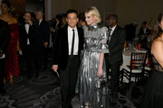 Lucy Boynton was all aglow with this metallic silver purse and dress combo at the 2020 Golden Globes.