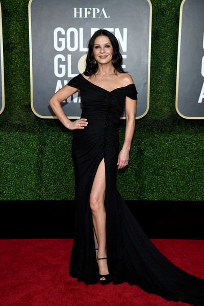 Catherine Zeta-Jones went for classic glamour in a ruched black off-shoulder gown with a high slit at the 2021 Golden Globe Awards.