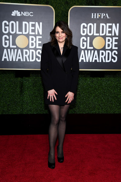 Tina Fey looked sharp in a black tux dress by Versace at the 2021 Golden Globe Awards.