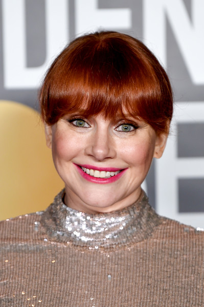 Bryce Dallas Howard wore her hair in a simple updo with eye-grazing bangs at the 2021 Golden Globe Awards.