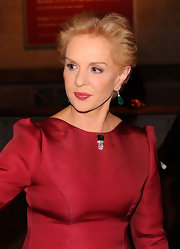 Carolina Herrera contrasted her red dress with green jewels at the Apollo Circle benefit.