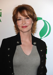 Sharon Lawrence turned up at a pre-Oscar party wearing her hair in short, casual layers with a military jacket.