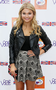 Stefanie Scott paired a black leather moto jacket with a floral mini skirt for a rocker-glam finish at the Kidstock Music and Art Festival.