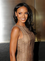 Model Selita Ebanks looked stunning in her blush tone dress. She donned a center part with long curls.