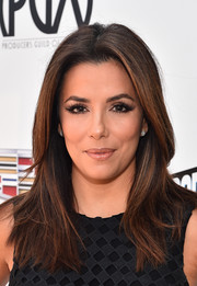 Eva Longoria attended the Produced By conference wearing a neat and stylish center-parted 'do.