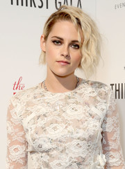 Kristen Stewart topped off her look with her signature smoky eye.