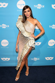 Olivia Culpo complemented her frock with strappy gold heels.