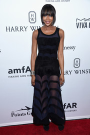 Naomi Campbell chose a scalloped, sheer-bottom tank dress for her amfAR Inspiration Gala look.