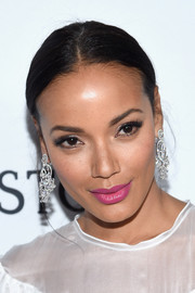 Selita Ebanks' pink lippy looked lovely against her white outfit.