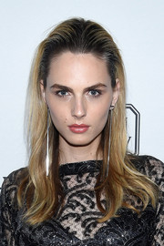 Andreja Pejic wore her hair down and slicked back at the top when she attended the amfAR Inspiration Gala.