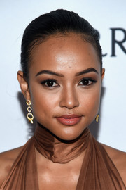 Karrueche Tran opted for a sleek ponytail when she attended the amfAR Inspiration Gala.