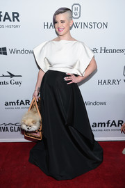 Kelly Osbourne donned a black-and-white gown with a boxy bodice and a voluminous skirt for the amfAR Inspiration Gala.