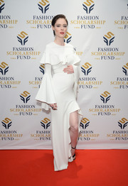 Coco Rocha looked festive in a white Christian Siriano maternity dress with a ruffled yoke and bell sleeves at the National Merit Scholarship Awards.