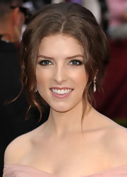 Actress Anna Kendrick looked wonderful in her blush colored Elie Saab dress, but her loose curled up-do fell a little flat, unfortunately.