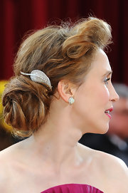 Vera continued to shine with a 1930's diamond clip brooches in platinum which she wore in a pinned back bun.