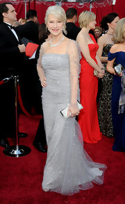 Amazing actress Helen Mirren attended the Academy Awards in a decadent Badgley Mischka dress, which she topped off with a stunning buckled clutch. She can do no wrong.