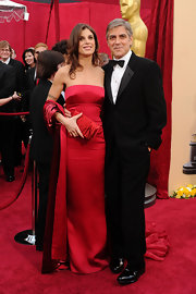 Current girlfriend of actor George Clooney, Elisabetta Canalis showed off a satin pleated red clutch. We wish she would have chose another color because it blends right into her dress.