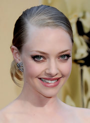 Up and coming actress Amanda Seyfried went for a simple yet effective sleek bun while attending the Academy Awards. Her Armani Prive' dress was so decadent her simple bun fit the dress well.