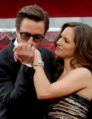 Susan Downey piled on the glitter at the Academy Awards, wearing a heavily beaded dress and a gorgeous diamond bracelet.